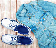 Sneakers and denim shirt Royalty Free Stock Images