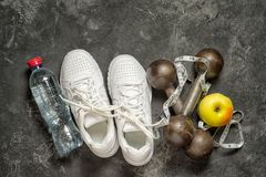 Sneakers, dumbbells healthy lifestyle concept. royalty free stock photography