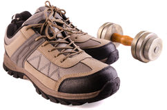 Sneakers and dumbbells Stock Photos