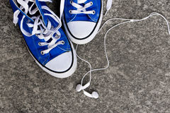 Sneakers and earphones Royalty Free Stock Images