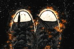 Sneakers on fire  in black background. Fire illustration Royalty Free Stock Photography