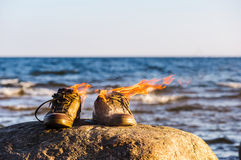 Sneakers in fire flames Royalty Free Stock Photos