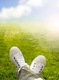 Sneakers in the grass Stock Images