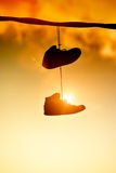 Sneakers hanging. From a cable Royalty Free Stock Images