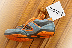 Sneakers hanging on the  door handle. Stock Image