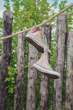 Sneakers hanging on a rope in the garden. Stock Image