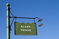 Sneakers Hanging on Sign Royalty Free Stock Photography