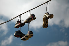 Sneakers Hanging on a Telephone Line Royalty Free Stock Image