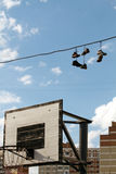 Sneakers Hanging on a Telephone Line Royalty Free Stock Photos