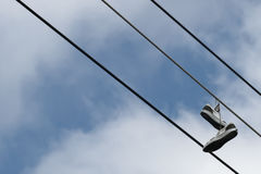 Sneakers hanging from wire Royalty Free Stock Images