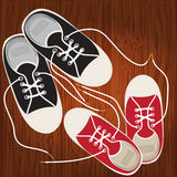 Sneakers on the hardwood floor of lace Stock Photography