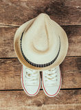 Sneakers and hat. On wooden background Stock Photography