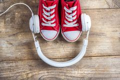 Sneakers and headphones Stock Image