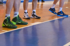 Sneakers on his feet Royalty Free Stock Photo