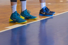 Sneakers on his feet Royalty Free Stock Image