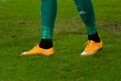 Sneakers on his feet Royalty Free Stock Photography