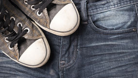 Sneakers on jean pants Stock Photography