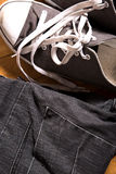 Sneakers and jeans Stock Image