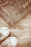 Sneakers and jeans on wooden background Royalty Free Stock Photography