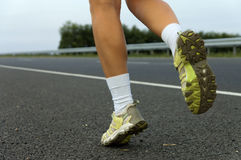 Sneakers on the jogging girl close-up. Royalty Free Stock Photos
