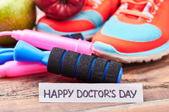 Sneakers, jump rope and card. Stock Images