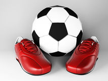 Sneakers near soccer ball Stock Photos