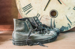 Sneakers and old clock Stock Photo