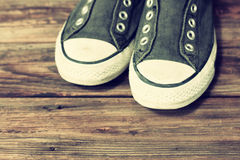 Sneakers on old deck. Sneakers on old wooden deck pic stock photography