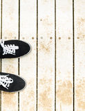 Sneakers on old grunge wooden background Royalty Free Stock Image