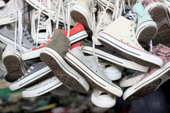 Sneakers of old shoes second hand. Stock Photo