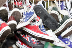 Sneakers of old shoes second hand. Royalty Free Stock Photography