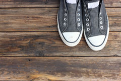Sneakers on  old wooden deck. Stock Photos