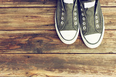 Sneakers on old wooden deck. Sneakers on wooden deck pic Royalty Free Stock Image