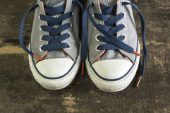 Sneakers on an old wooden surface. Royalty Free Stock Photo