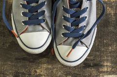 Sneakers on an old wooden surface. Stock Image