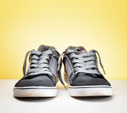 Pair of grey sneakers  Stock Images