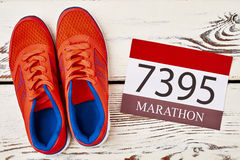Sneakers and participant number. How to train to marathon Royalty Free Stock Photo