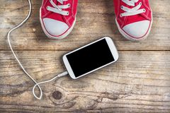Sneakers and phone Royalty Free Stock Photo