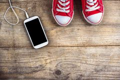Sneakers and phone Stock Photography