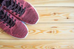 Sneakers pink on a wooden background top view Stock Photography