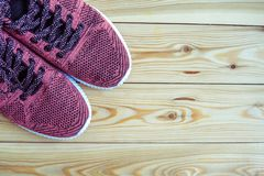 Sneakers pink on a wooden background top view Royalty Free Stock Photo