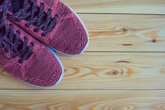 Sneakers pink on a wooden background top view Stock Images