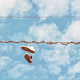Sneakers on the power line, retro photo filter Stock Image