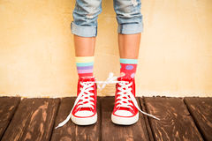 Sneakers. Red sneakers on children legs Stock Images