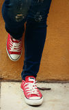 Sneakers or red shoes Royalty Free Stock Photo