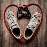 Sneakers and resistance band Royalty Free Stock Images