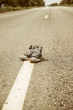 Sneakers on the road. Stock Photos