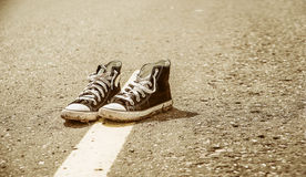 Sneakers on the road. Road. journey Royalty Free Stock Photo