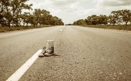 Sneakers on the road. Stock Image