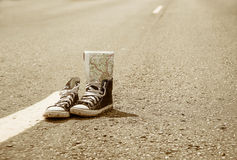 Sneakers on the road. road. journey.  Stock Photos